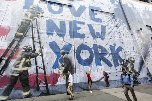 Street Art Tribute of 9 11 Victims A mural by the artist Mr Brainwash is seen on the side of the Ce